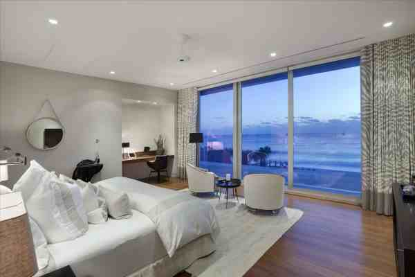 modern bedroom with ocean view Fully Automated Oceanfront Florida House with Amazing Lighting is for Sale