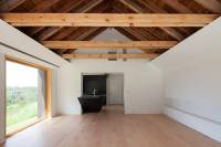 Renovated Home Has Open Vaulted Ceiling with Exposed Beams