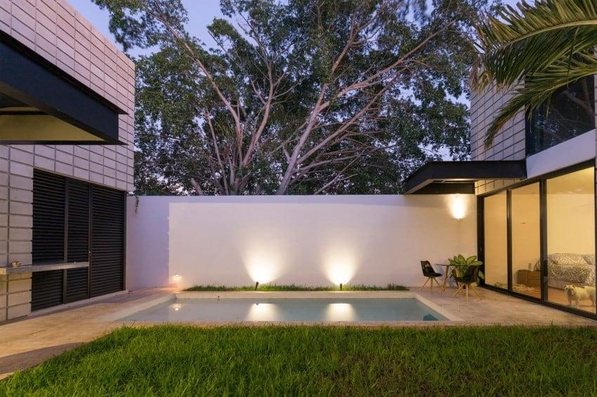 CShaped Concrete Block Home Wraps Around Swimming Pool Courtyard