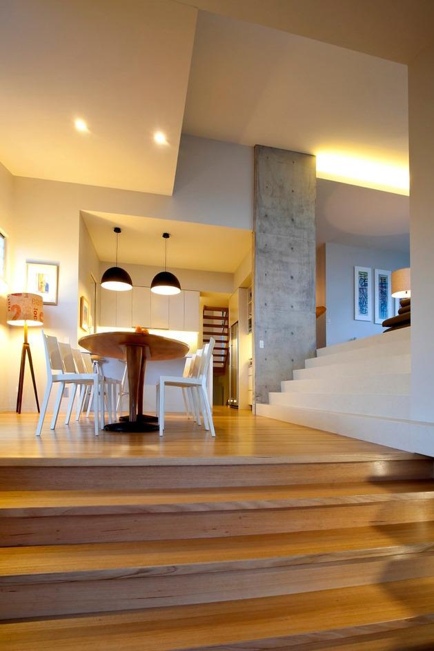 kitchen corner bench seating chef appliances bold exterior beach house with minimalist interiors