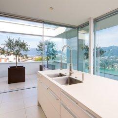 Lights Over Kitchen Island Hanging Rack Minimalist Mountain Top Home Designed Around Panoramic ...