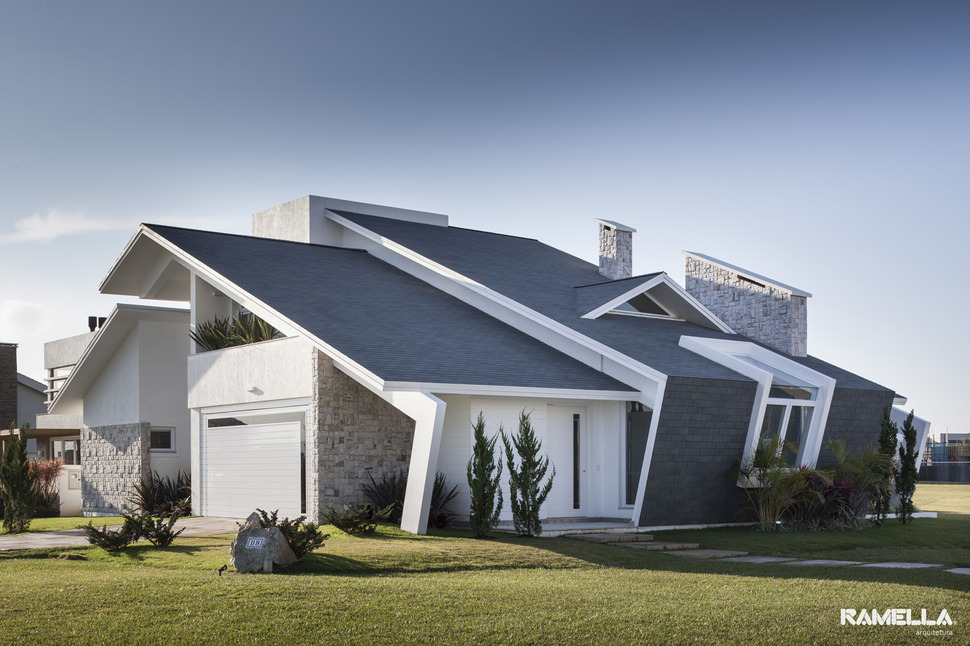 Pitched Roofline On House Morphs Into Angled Facade