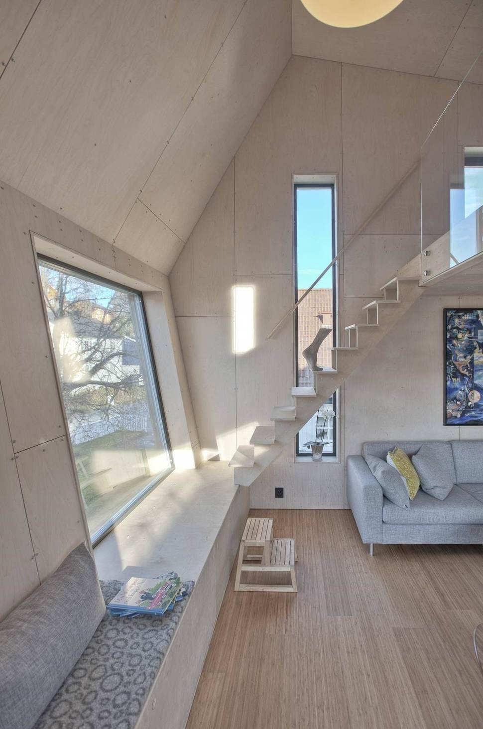Angular Home Addition With PlywoodLined Interior