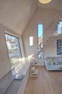 Angular Home Addition With Plywood-Lined Interior