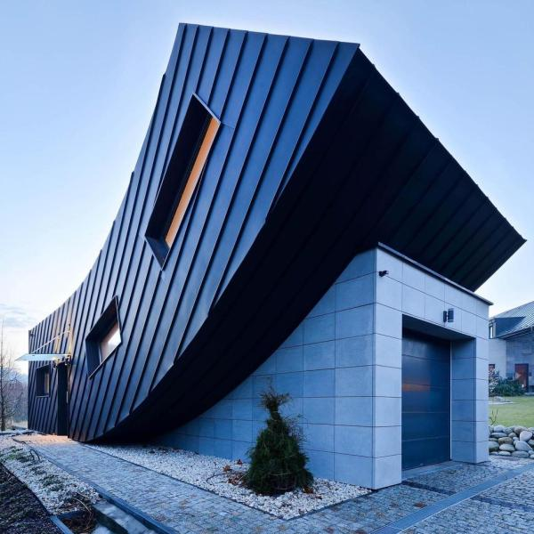 Small Home Creates Large Statement With Vertically Curved