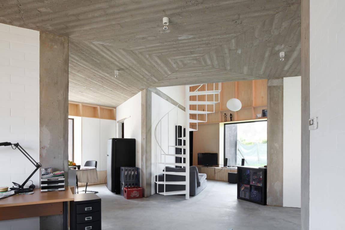 Belgium Angle House With Concrete Wood And Brick Interiors