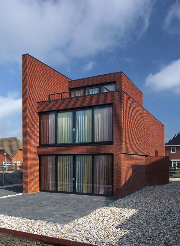 contemporary art for kitchen painted chairs brick wall house boasts minimalist style with maximum appeal