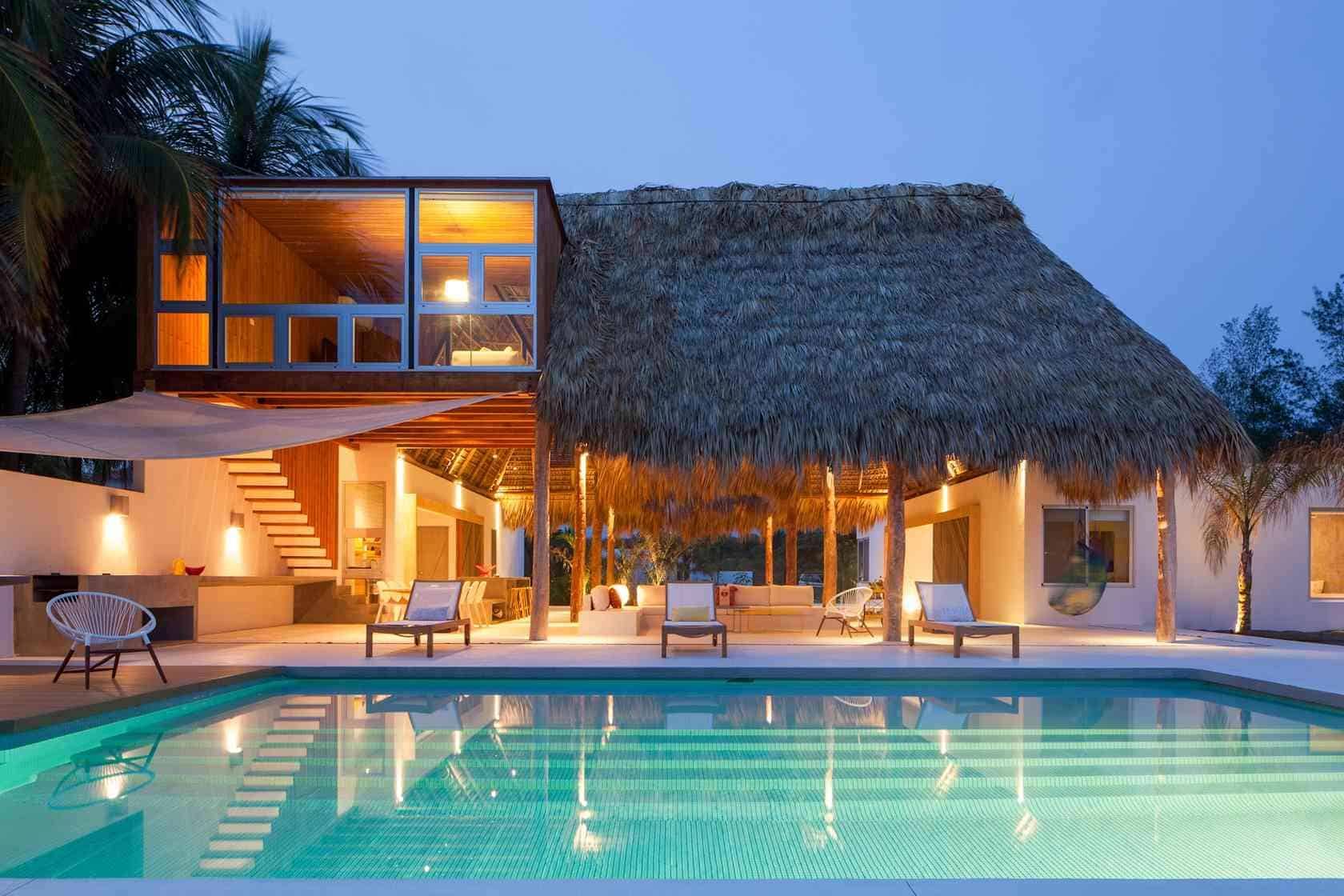 Colorful Tropical Open Home With RoughCut Thatched Roof