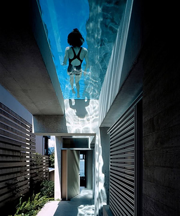 Cool Concrete House With Hot Swimming Pool Feature Above Main Entrance