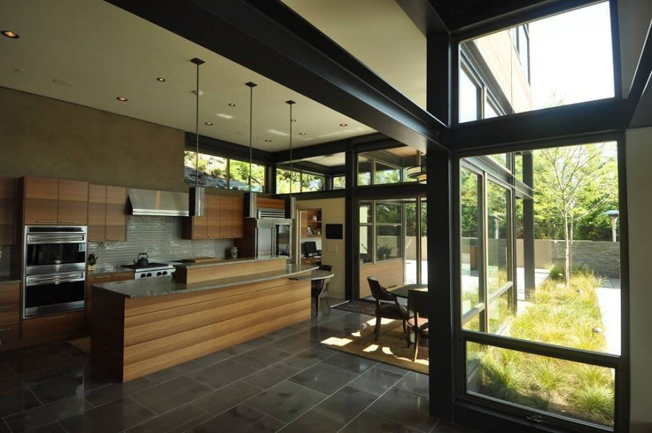 Grand Glass Lake House With Bold Steel Frame