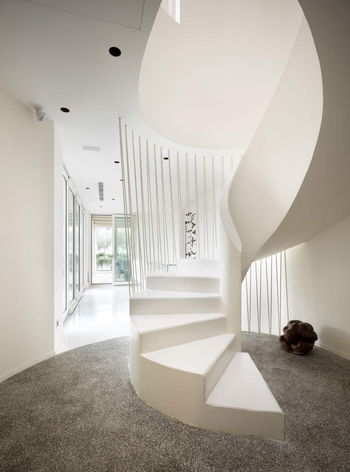 White Shades Define Luxurious Multistory Milan Apartment