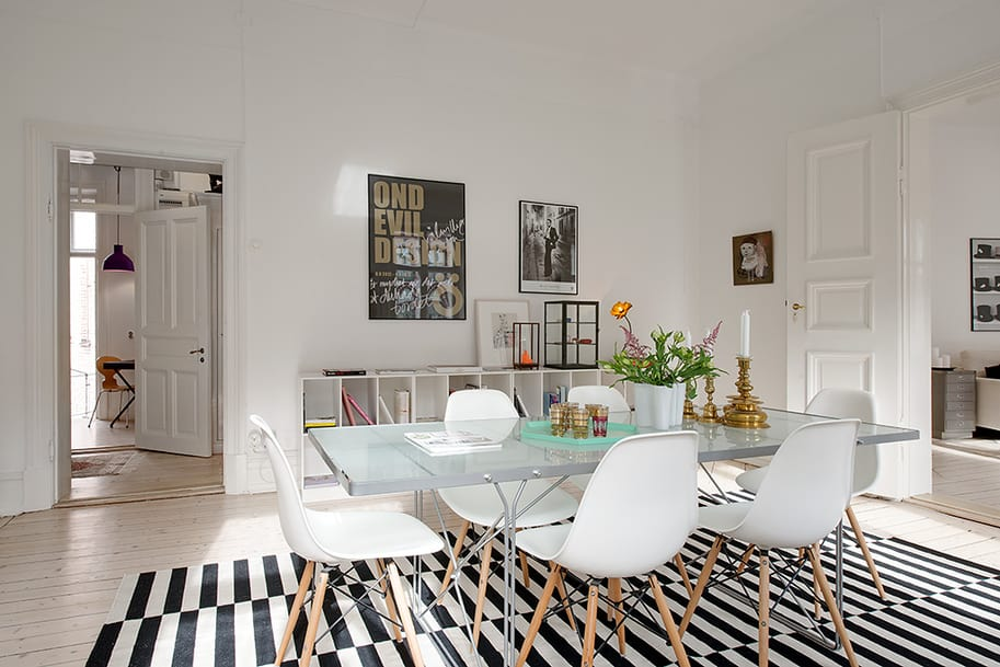 black and white striped chairs reclining toddler chair renovated heirloom apartment combines original details with modern decor