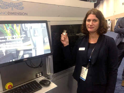 Galit Beck of Nano Dimension displays a wafer-thin PCB printed by the Nano Dimension DragonFly.