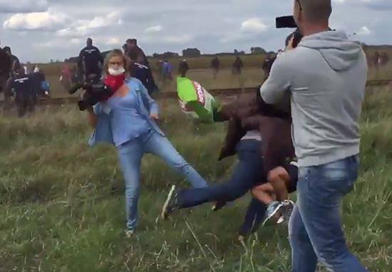 UNILADs Shocking Video Shows Hungarian Camerawoman Kicking And Tripping Fleeing Refugees image