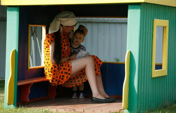 Many of the Russian women's camps have their own children's homes.  Here a prisoner in Krasnoyarsk is playing with her child.  (July 2007)