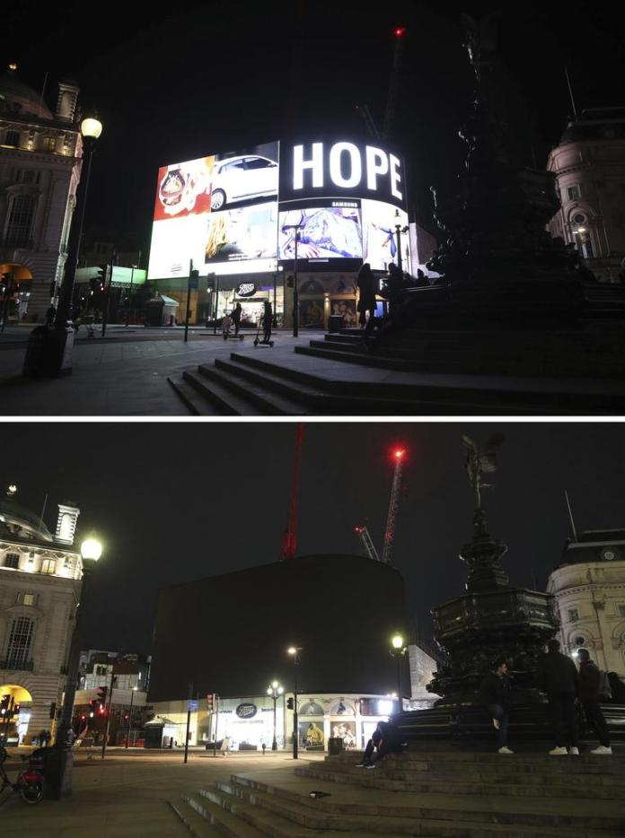 No hope anymore.  Or maybe yes?  Lights go out at Piccadilly Circus in London.  (See more pictures below.)