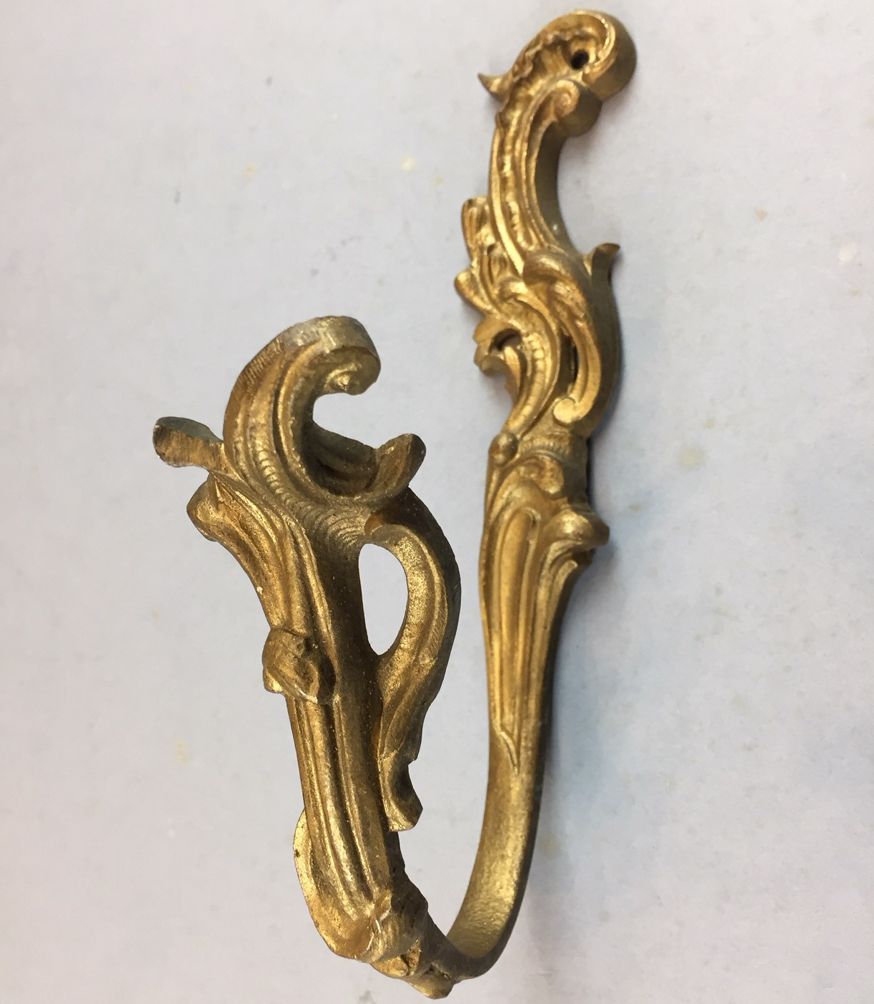 pair of antique gilded brass curtain tie backs