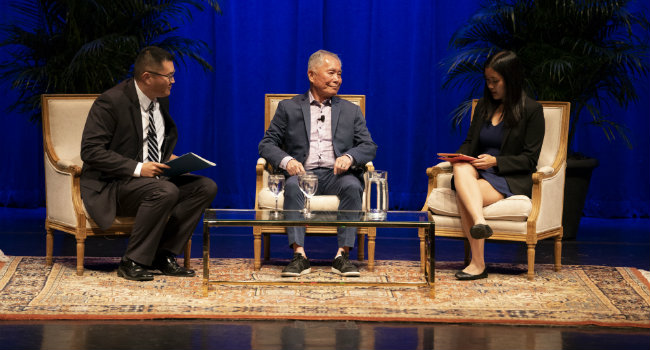(L to r) E. Bronson Ingram Chair in Economics Kitt Carpenter, Chancellor's Lecturer George Takei and Alyson Win with the Asian American Student Association during the Q&A. (Joe Howell/Vanderbilt)