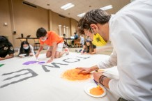 Students in Carmichael Towers participate in Art Night-Leave your legacy on a Towers banner (this event captures Towers RA building a community identity through a mural that will be displayed in the lobby).