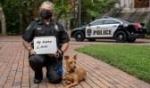 Vanderbilt Police Sergeant Cheryl Bradley with K9 Levi shows who she masks up for as she practices healthy behaviors outside Kirkland Hall.