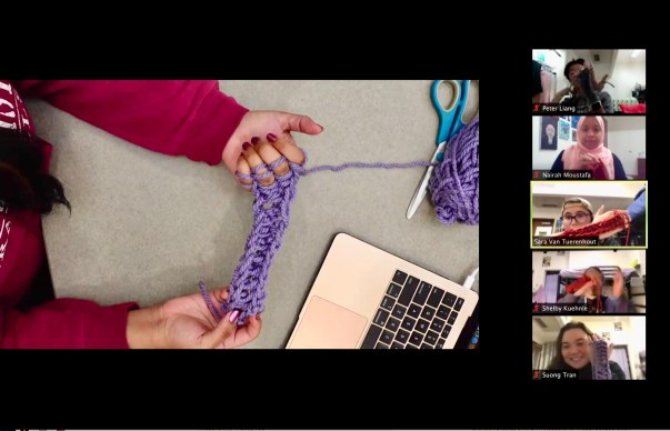 A fellow student teaches the group how to finger weave during a Bronson break.