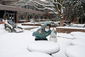 A student poses for a picture during this week's winter weather.