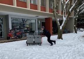 Campus Dining staff deliver meals to students throughout the week.