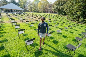 Anish Raman walks through the COVID-19 memorial's 281 chairs set up on Library Lawn in April 2021.