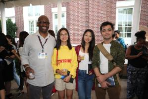 Frank Dobson, left attends the Welcome Reception for International Students at the Dean's Residence.