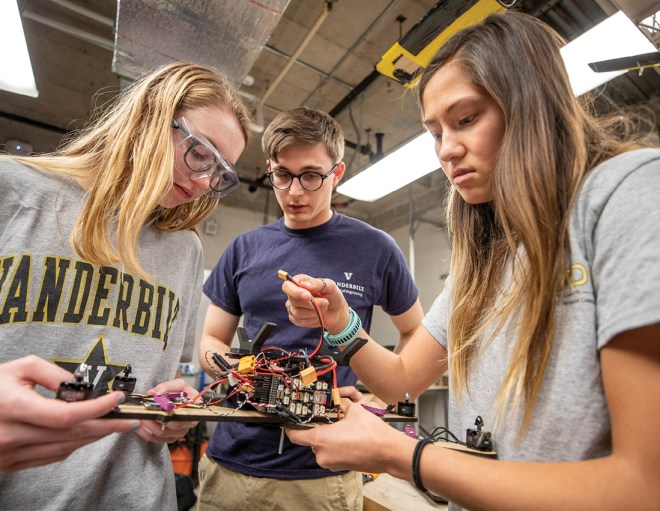 Emily Herron (left), Nick Belsten (center) and Sara Tsai test a proto control board for an autonomous unmanned aerial vehicle to be flown at this year's NASA Student Launch Competition. (Vanderbilt University/John Russell)
