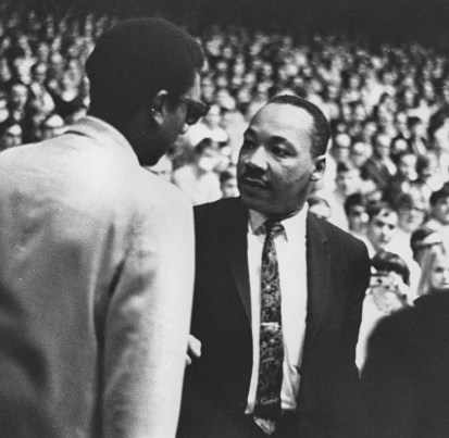"""Nobel Peace Prize winner and civil rights leader Rev. Martin Luther King Jr. (shown speaking to """"black power"""" leader Stokely Carmichael)"""