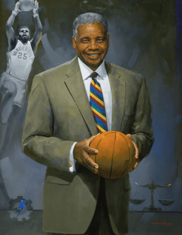 Portrait of Perry Wallace holding a basketball