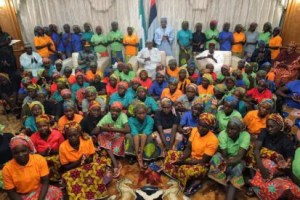 82 Chibok girls with President Buhari shortly before leaving for London