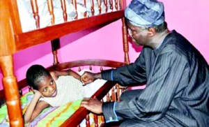 •Fashola with one of the sick children