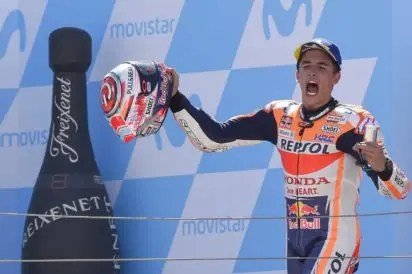 46f0f6fcc1fd Repsol Honda Team s Spanish rider Marc Marquez celebrates on the podium  after winning the MotoGP race of the Moto Grand Prix of Aragon at the  Motorland ...