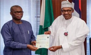 Buhari receiving WAEC certificate from the Registrar of the West African Examinations Council (WAEC)