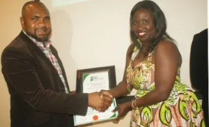 Mr Innocent Oboh, President and CEO, Dijo Communications receiving the Diamond Award for the Best Marketing Agency of the Year 2018 by Ms Emma Wenani, Business Director, Global Media Alliance at the Nigeria Brand/Africa brand Awards in Lagos recently.