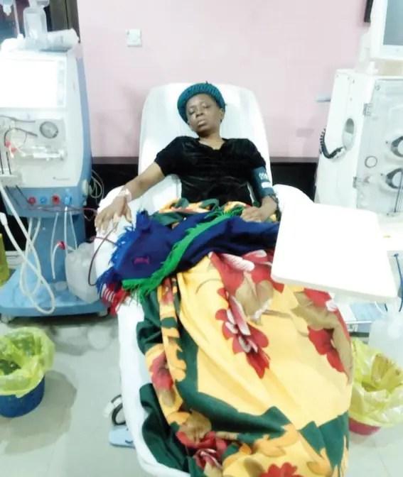 Oge Azike on hospital bed