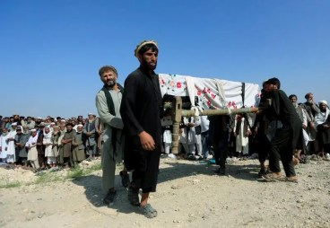 Men carry a coffin of one of the victims after a drone strike, in Khogyani district of Nangarhar province, Afghanistan September 19, 2019