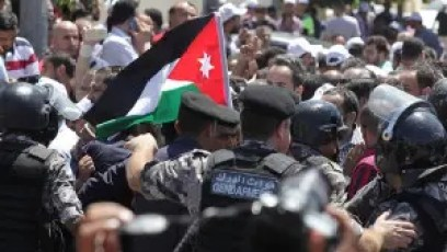 Teachers jostle with security forces during a protest in Amman
