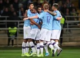 Man City players celebrate against Shakhtar Donetsk