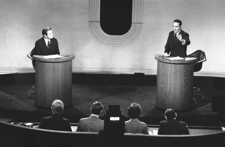 Mondale listens as Dole answers the first question during the 1976 VP debate. (AP File Photo)