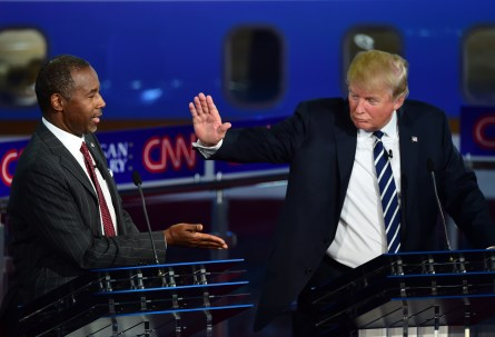 Republican presidential hopefuls  Ben Carson and Donald Trump participate in the Republican Presidential Debate at the Ronald Reagan Presidential Library in Simi Valley, California on September 16, 2015. Republican presidential frontrunner Donald Trump stepped into a campaign hornet's nest as his rivals collectively turned their sights on the billionaire in the party's second debate of the 2015.  AFP PHOTO / FREDERIC J. BROWN        (Photo credit should read FREDERIC J. BROWN/AFP/Getty Images)
