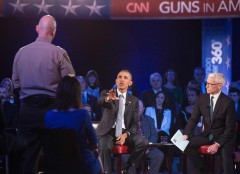 US President Barack Obama replies to a question by Arizona Sheriff Paul Babeu (L) at a town hall meeting with CNN's Anderson Cooper (R) on reducing gun violence at George Mason University in Fairfax, Virginia, on January 7, 2016. Obama announced limited measures two days ago to tackle rampant US gun violence and called on Americans to punish lawmakers who oppose more meaningful reforms.   AFP PHOTO/NICHOLAS KAMM / AFP / NICHOLAS KAMM        (Photo credit should read NICHOLAS KAMM/AFP/Getty Images)