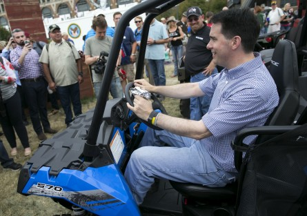 Walker sits in an ATV while touring the midway at the Iowa State Fair on Monday.  (Al Drago/CQ Roll Call)