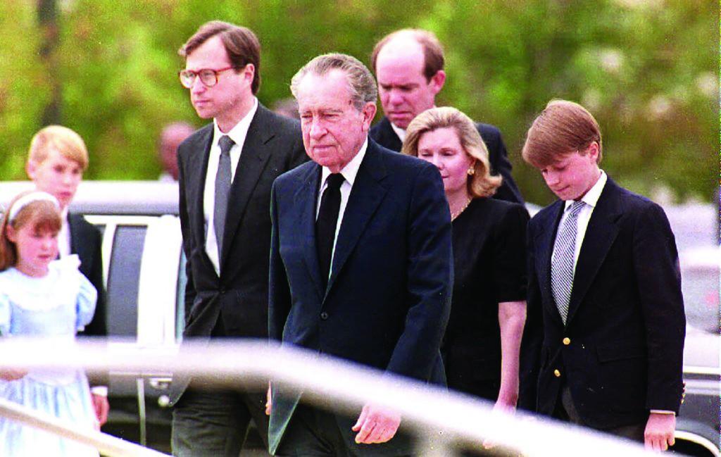 Ed Cox, left, walks with father-in-law Richard Nixon and his wife Tricia Nixon Cox, second from right, at the funeral of Nixon's wife Pat in 1993. (Mike Nelson/AFP/Getty Images file photo)
