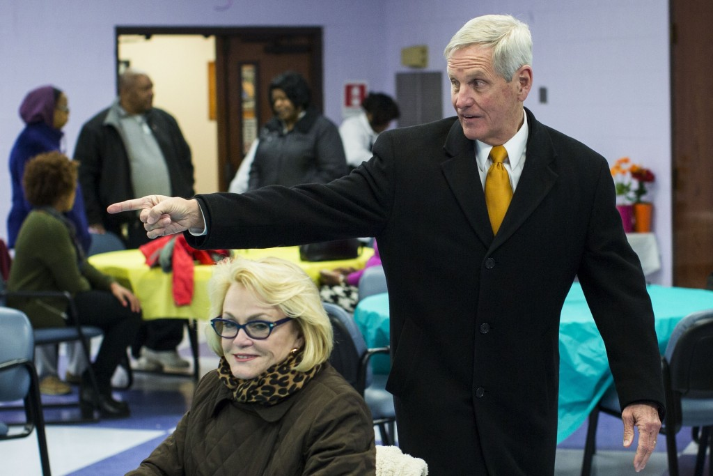 Hill, who is hoping to take advantage of Trump's candidacy, meets voters in Indianapolis earlier this month. (Photo By Al Drago/CQ Roll Call)