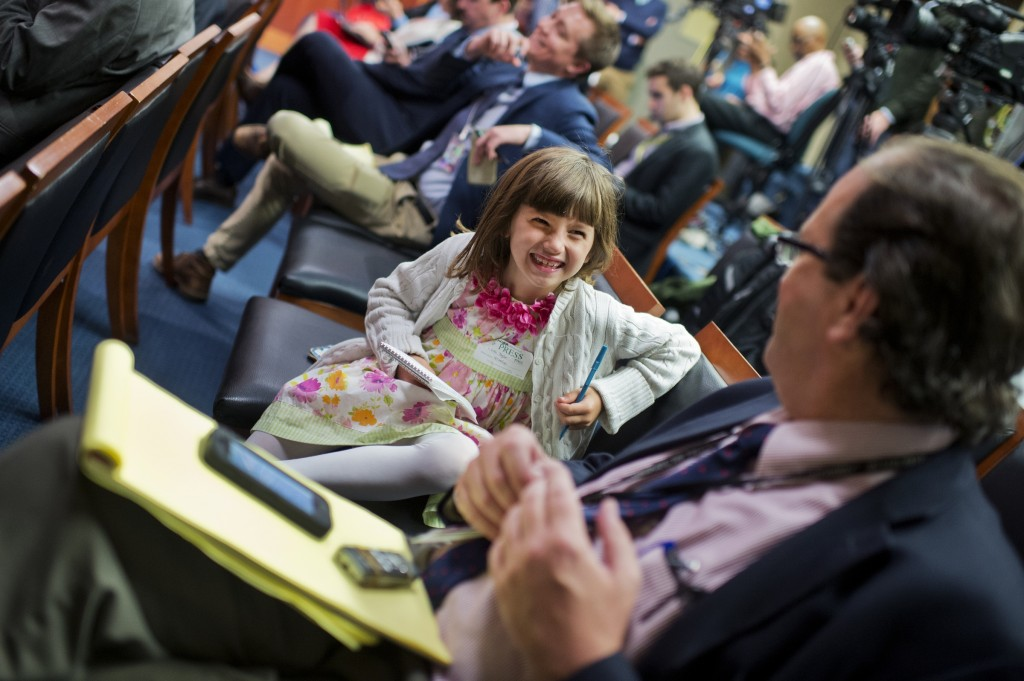 Lexi Taylor, 6, attends a news conference in the Capitol's Senate studio with her father Andrew Taylor of the Associated Press. (Tom Williams/CQ Roll Call)