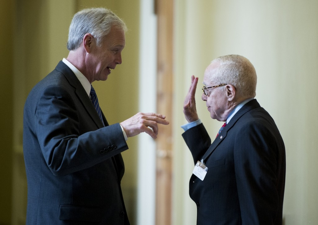 Mukasey, right, talks with Sen. Ron Johnson outside the GOP lunch Wednesday. (Bill Clark/CQ Roll Call)