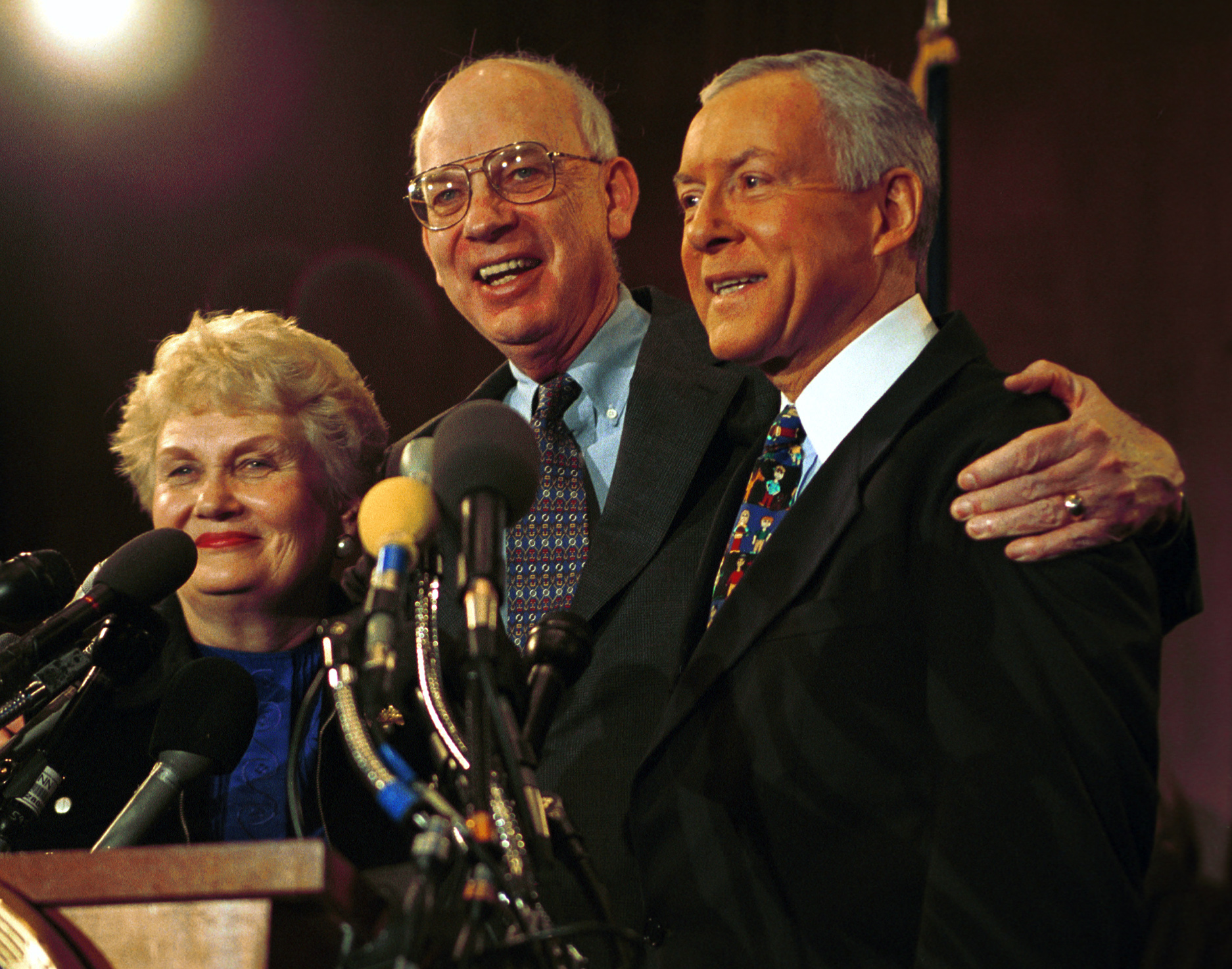 Utah Sen. Orrin Hatch, with Sen. Bob Bennett and Hatch's wife Elaine shortly after announcing he would drop out of the presidential race and endorse fellow Republican candidate George W. Bush. (Tom Williams/Roll Call)